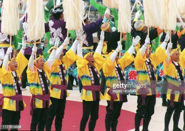Japanese performers shout during the opening ceremony for the XVIII Winter Olympic Games at Minami Nagano stadium in Nagano 07 February AFP PHOTO