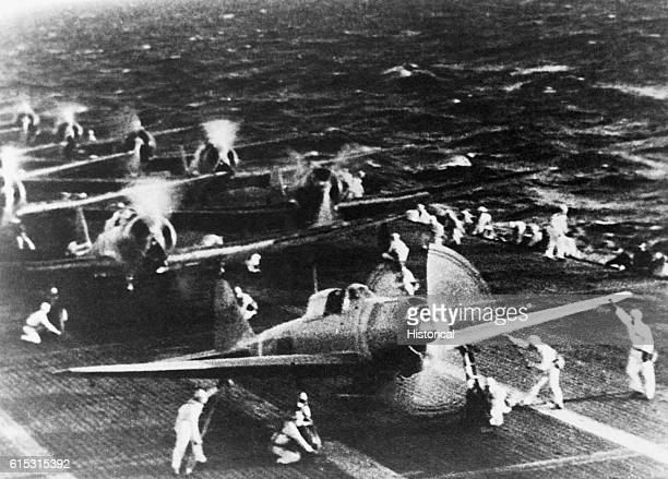 A Japanese photograph shows Mitsubishi dive bombers warming up on the deck of a carrier in the Pacific before their attack on Pearl Harbor in the...