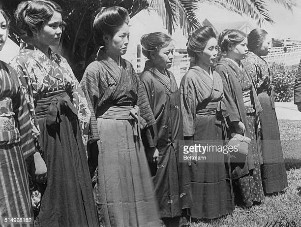 Japanese picture brides arrive at Angel Island and are lined up for passport inspection before meeting their new husbands