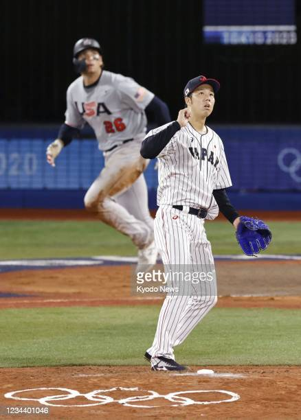 Japanese pitcher Koyo Aoyagi allows a three-run home run to Triston Casas of the United States in the fifth inning of their Tokyo Olympic...