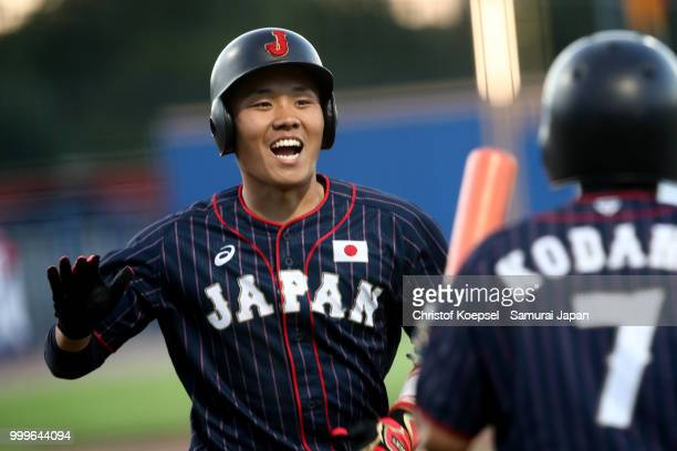The team of Japan enters the pitch to the Haarlem Baseball Week game between Cuba and Japan at Pim Mulier Stadion on July 15 2018 in Haarlem...