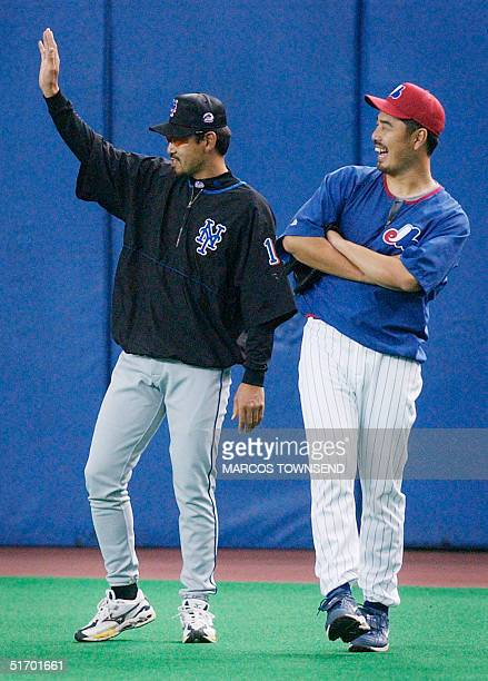 Japanese pitchers New York Mets' Satoru Komiyama and Montreal Expos' Masato Yoshii share a laugh during the Expos' practice at the Olympic Stadium in...