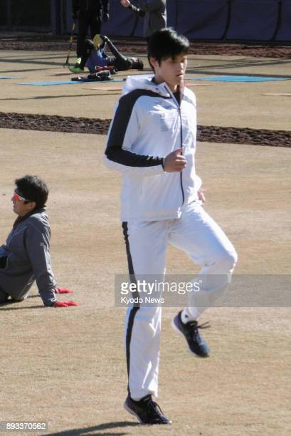Japanese pitcherslugger Shohei Ohtani works out at the Nippon Ham Fighters' training facility in Kamagaya Chiba Prefecture on Dec 12 after returning...