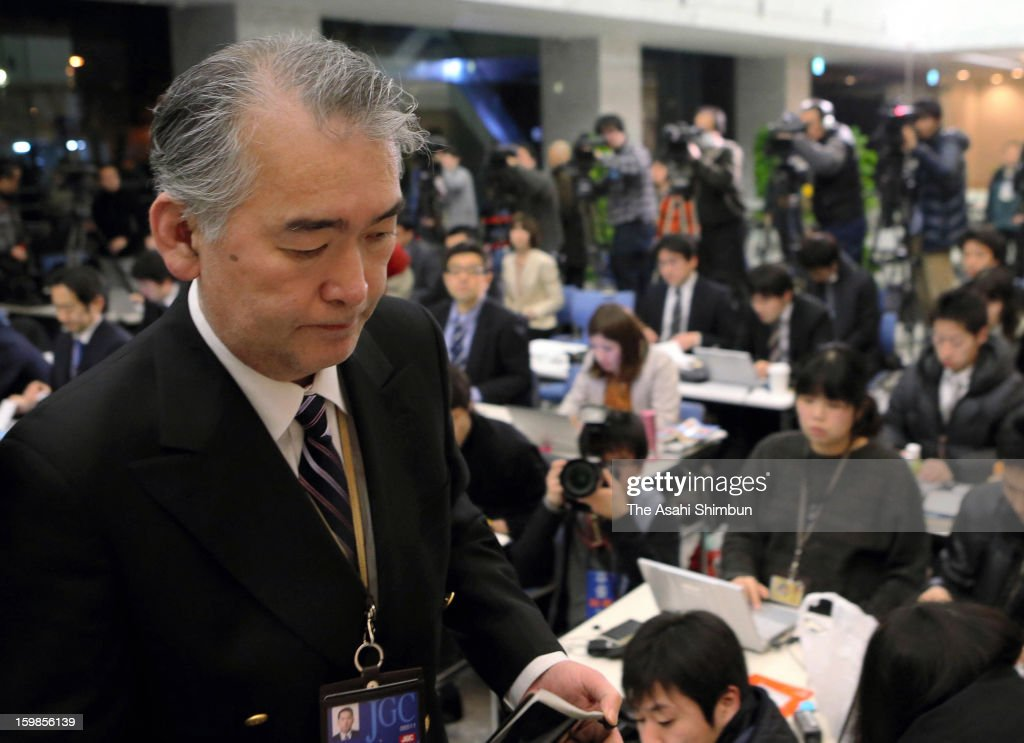 Japanese plant construction company JGC Co spokesman Takeshi Endo leaves after a press conference at their headquarters on January 22, 2013 in Yokohama, Kanagawa, Japan. Japanese government officials, president and staffs of Japanese plant constructor JGC Co, who are in In Anemas confirmed seven Japanese nationals were killed in the Algerian hostage crisis.