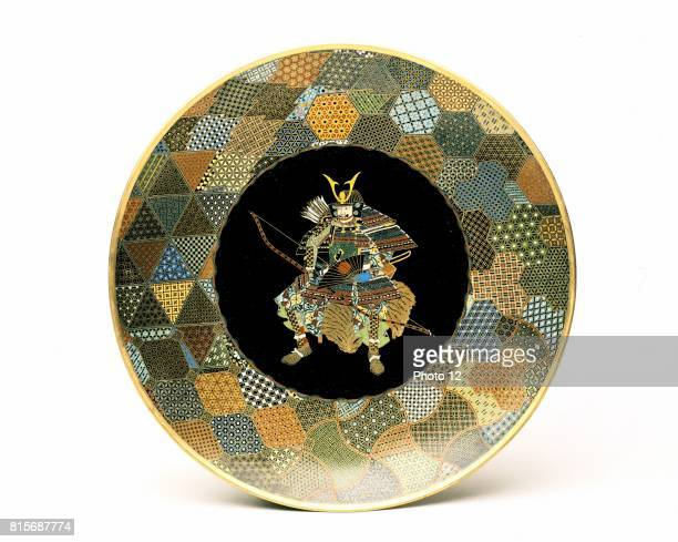 Japanese plate Seated warrior in full armour holding bow and fan quiver of arrows on his back Cloisonne enamel on copper 185075 Victoria Albert...