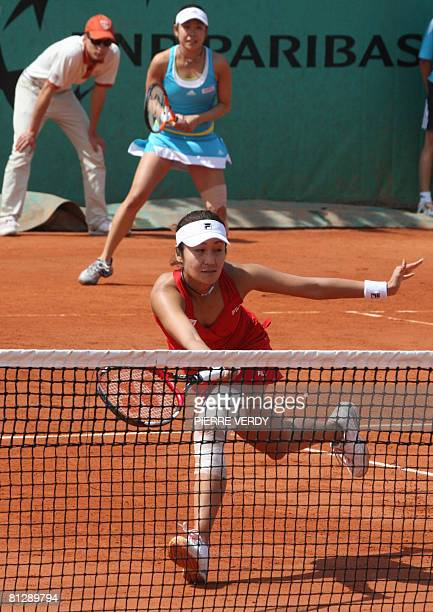 Japanese player Akiko Morigami and Japanese player Aiko Nakamura return a ball during the first round double of the French Tennis Open against TAipei...