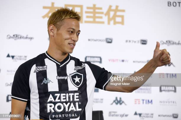 Japanese player Keisuke Honda gives a thumb up during a press conference as part of the new player of the Brazilian team Botafogo at Engenhao Stadium...