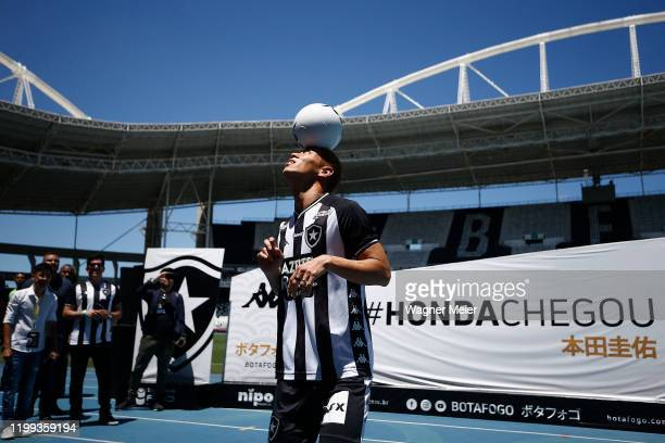 Japanese player Keisuke Honda plays with the ball during his presentation of the Brazilian team Botafogo to the fans at Engenhao Stadium on February...