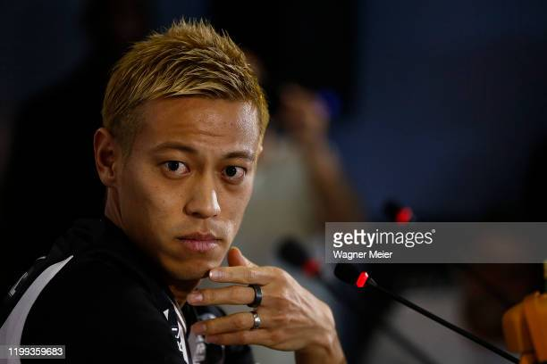 Japanese player Keisuke Honda speaks during a press conference as part of the new player of the Brazilian team Botafogo at Engenhao Stadium on...