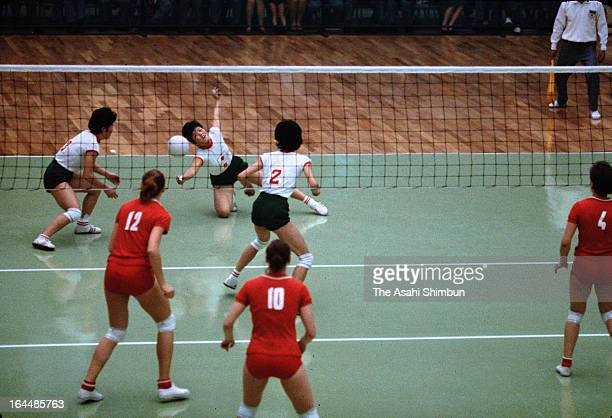 A Japanese player receives the ball during the Women's Volleyball final between Japan and Soviet Union during Tokyo Olympic at Komazawa Gymnasium on...