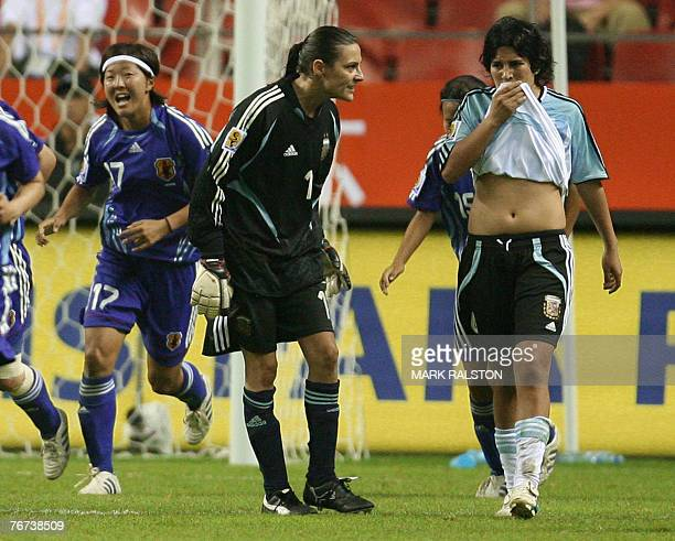 Japanese player Yuki Nagasato celebrates after scoring as Argentinian goalie Romina Ferro yells at teammate Gabriela Chavez during their 2007 FIFA...