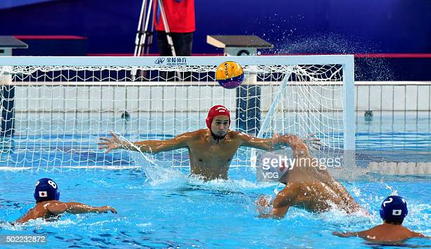 Japanese players and Chinese players compete during the final match of the Asian Water Polo Championship on December 20 2015 in Foshan Guangdong...