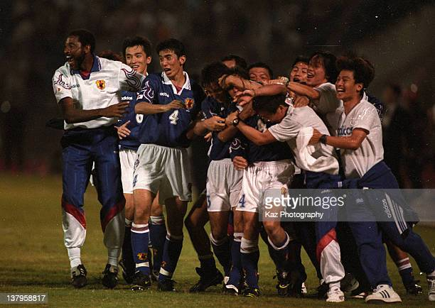 Japanese players and coaches celebrate Masayuki Okano's golden goal during the 1998 France World Cup Asian Playoff match between Japan and Iran at...