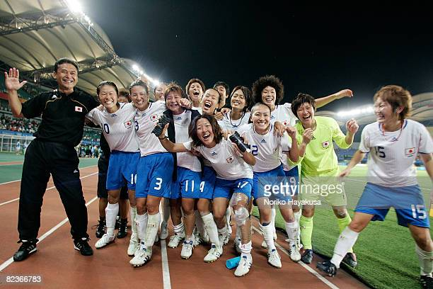 Japanese players and coaches celebrate the win over China after the Women's Quarter Final match between China and Japan at Qinhuangdao Olympic Sports...
