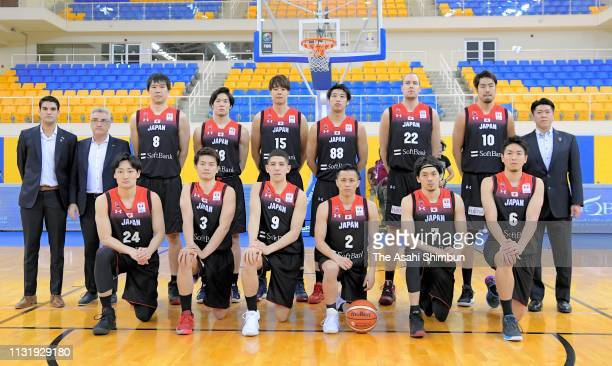 Japanese players and coaches pose for photographs prior to the FIBA World Cup Asian Qualifier 2nd Round Group F match between Qatar and Japan on...