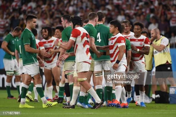 Japanese Players and Irish players shake the hand after the final whistle during the Rugby World Cup 2019 Group A game between Japan and Ireland at...