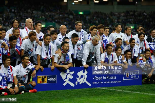 Japanese players and staffs celebrate their 20 victory and qualified for the FIFA World Cup Russia after the FIFA World Cup Qualifier match between...