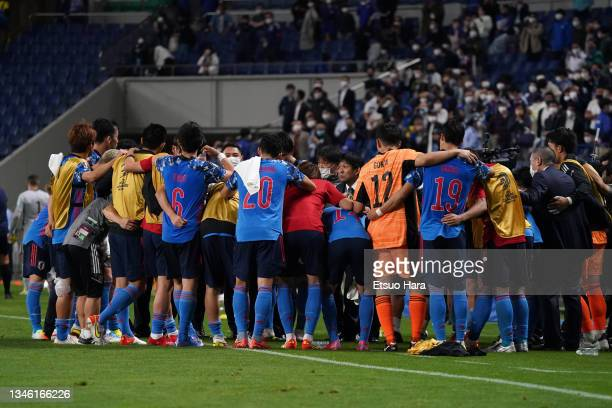 Japanese players and staffs huddle after their 2-1 victory in the FIFA World Cup Asian qualifier final round Group B match between Japan and...