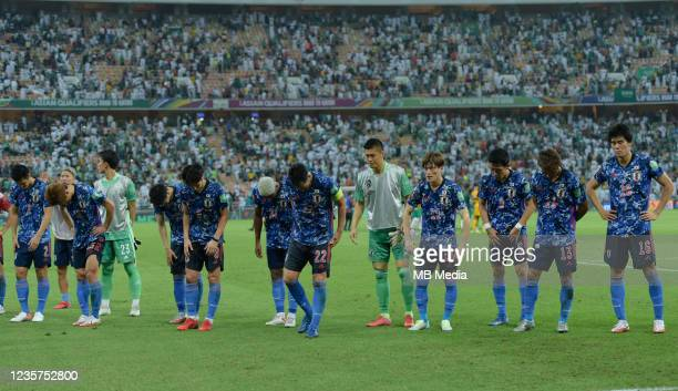 Japanese players bow to the fans after their defeat to Saudi Arabia in the 2022 FIFA World Cup Qualifier match at King Abdullah Sports City on...