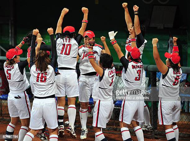 Japanese players celebrate after Eri Yamada's fouth inning homerun off a pitch by Cat Osterman of the US in their gold medal final at the Fengtai...