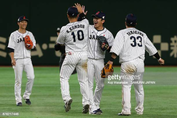 Japanese players celebrate after the Eneos Asia Professional Baseball Championship 2017 final game between Japan and South Korea at Tokyo Dome on...