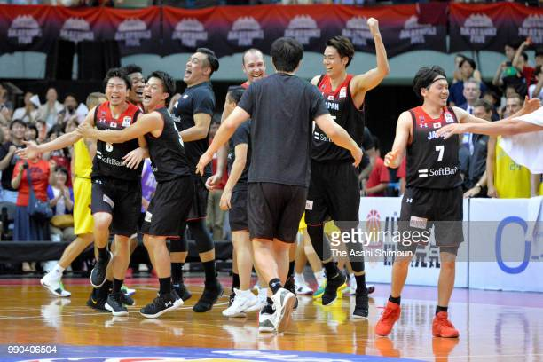 Japanese players celebrate during the FIBA World Cup Asian Qualifier Group B match between Japan and Australia at Chiba Port Arena on June 29 2018 in...
