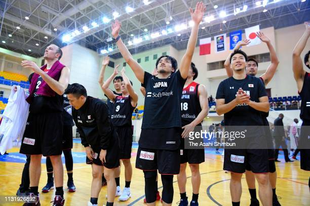 Japanese players celebrate qualified for the World Cup after their victory in the FIBA World Cup Asian Qualifier 2nd Round Group F match between...