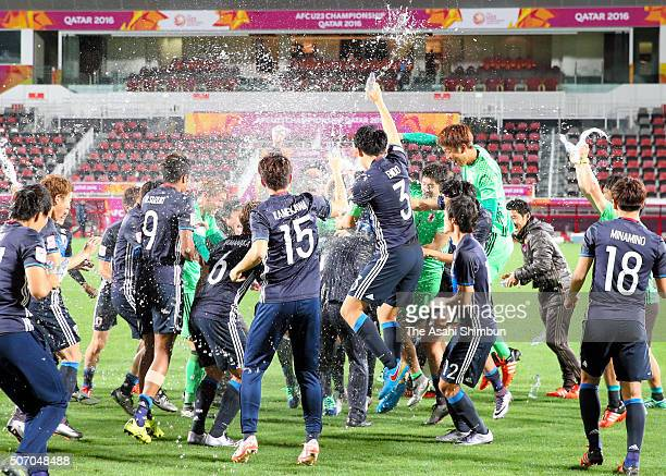 Japanese players celebrate qualifying for the Rio de Janeiro Olympics after their 21 win in the AFC U23 Championship semi final match between Japan...