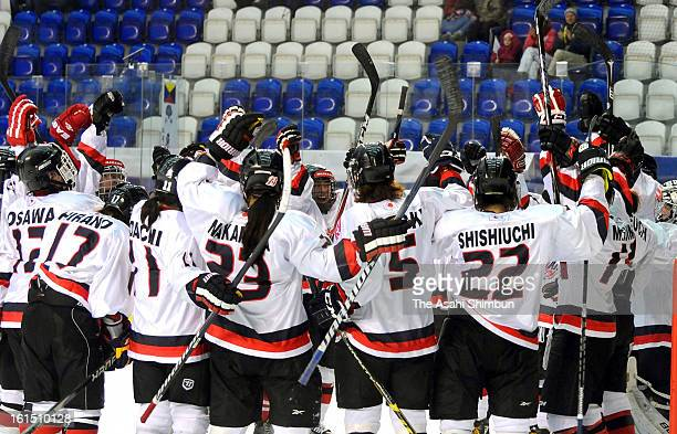 Japanese players celebrate the qualification to Sochi Olympic after the Women's Oylmpic Ice Hockey Qualification Tournament Group C match between...