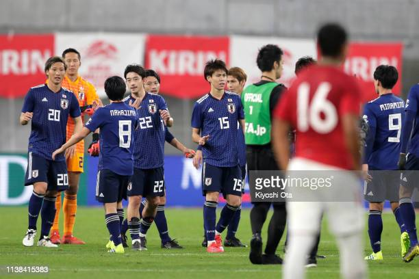 Japanese players celebrate the team's 10 victory in the international friendly match between Japan and Bolivia at Noevir Stadium Kobe on March 26...
