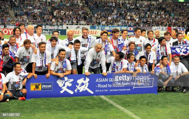 Japanese players celebrate their 20 victory and qualification for the FIFA World Cup Russia after the FIFA World Cup Qualifier match between Japan...
