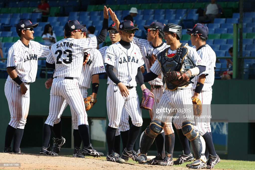 Japanese players celebrate their 3-0 victory during the 28th Asian Baseball Championship Super Round match between Japan and South Korea at Hsing-Chuang Stadium on October 6, 2017 in New Taipei City, Taiwan.