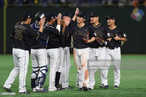 Japanese players celebrate their 41 win in the World Baseball Classic Pool B Game Three between Japan and Australia at Tokyo Dome on March 8 2017 in...