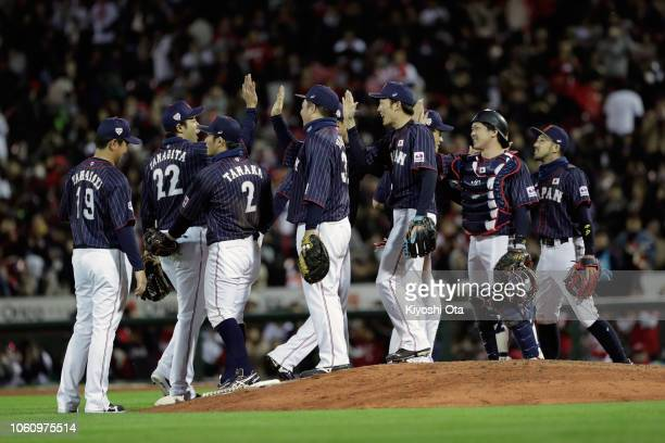 Japanese players celebrate their 53 victory in the game four between Japan and MLB All Stars at Mazda Zoom Zoom Stadium Hiroshima on November 13 2018...