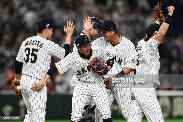 Japanese players celebrate their 58 victory in the World Baseball Classic Pool E Game Four between Cuba and Japan at the Tokyo Dome on March 14 2017...