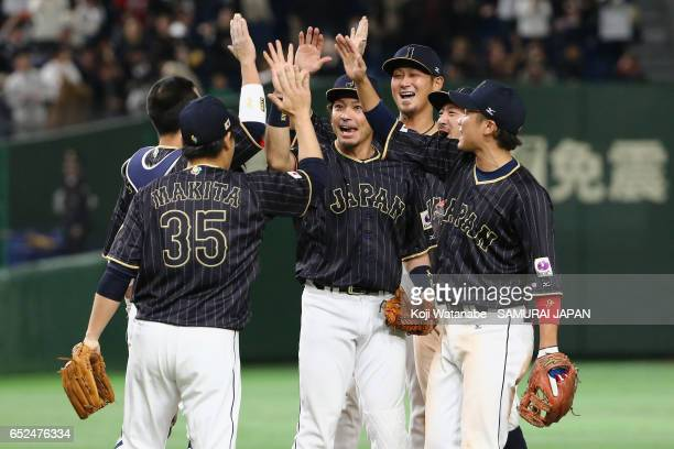 Japanese players celebrate their 8-6 victoty in the World Baseball Classic Pool E Game Two between Japan and Netherlands at the Tokyo Dome on March...