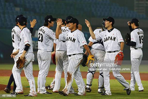 Japanese players celebrate their 93 win after the WBSC Premier 12 quarter final match between Japan and Puerto Rico at the Taoyuan International...