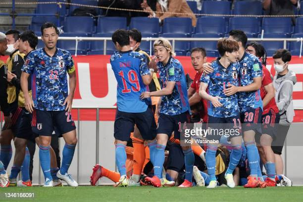Japanese players celebrate their second goal during the FIFA World Cup Asian qualifier final round Group B match between Japan and Australia at...