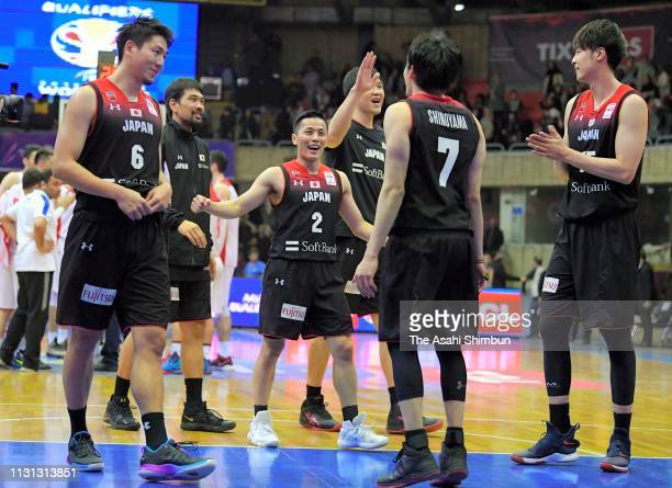 Japanese players celebrate their victory after the FIBA World Cup Asian Qualifier 2nd Round Group F match between Iran and Japan on February 21 2019...