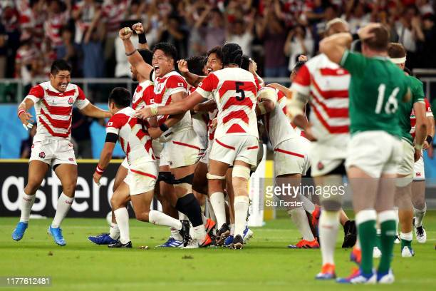 Japanese players celebrate their victory after the Rugby World Cup 2019 Group A game between Japan and Ireland at Shizuoka Stadium Ecopa on September...