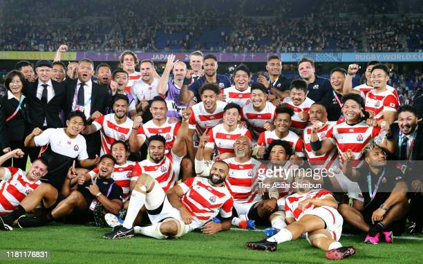 Japanese players celebrate their victory after the Rugby World Cup 2019 Group A game between Japan and Scotland at International Stadium Yokohama on...