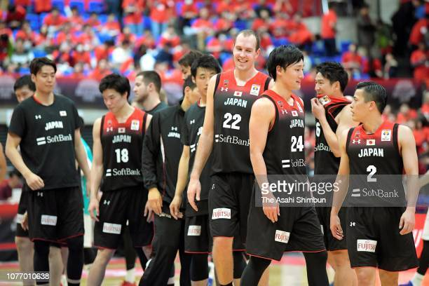 Japanese players celebrate their victory in the FIBA World Cup Asian Qualifier Group F match between Japan and Kazakhstan at Toyama City Gymnasium on...