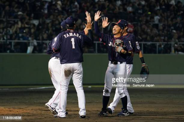 Japanese players celebrate their victory in the game two between Samurai Japan and Canada at the Okinawa Cellular Stadium Naha on November 1, 2019 in...