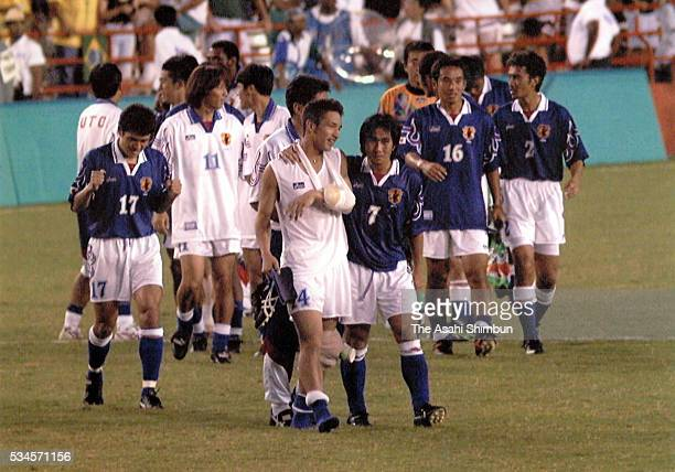 Japanese players celebrate their win over Brazil in the Men's Football Group D match between Japan and Brazil during the Atlanta Summer Olympic Games...