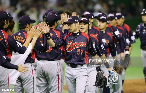 Japanese players celebrate their win over South Korea after the World Baseball Classic Tokyo Round match between Japan and South Korea at Tokyo Dome...
