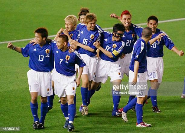 Japanese players celebrate winning the FIFA World Cup Korea/Japan Group H match between Japan and Russia at the International Stadium Yokohama on...