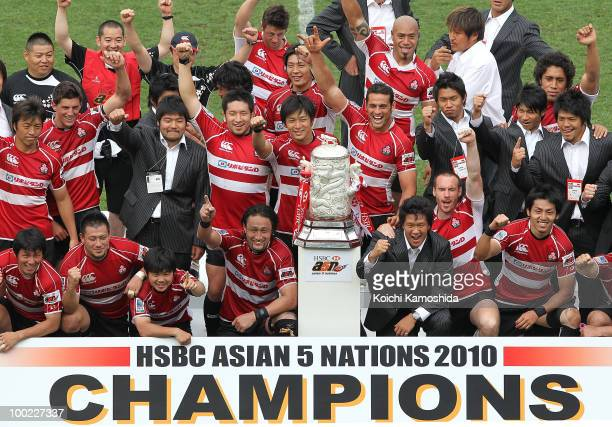 Japanese players celebrate with the trophy after winning the HSBC Asian 5 Nations match between Japan and Hong Kong at Prince Chichibu Stadium on May...