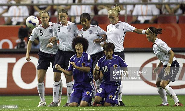 Japanese players Eriko Arakawa and Shinobu Ohno knee are seen in action in front of the England team during the 2007 FIFA Women's World Cup soccer...