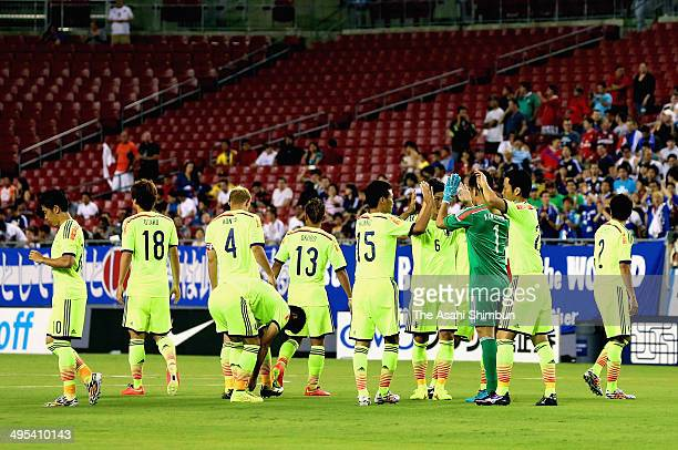 Japanese players high fives prior to the International Friendly Match between Japan and Costa Rica at Raymond James Stadium on June 2 2014 in Tampa...