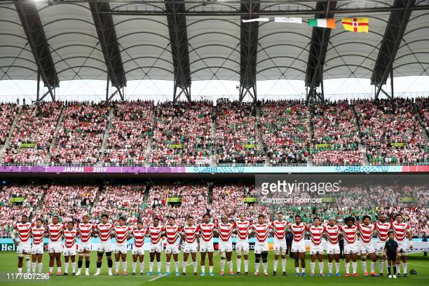Japanese players line up for the national anthem prior to the Rugby World Cup 2019 Group A game between Japan and Ireland at Shizuoka Stadium Ecopa...